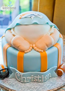 Cake with a Denver Broncos logo: Baby Christian's Orange & Blue Baby Shower | You're Welcome Events