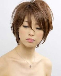 Like the color and cut, but I'd style it differently, with the bangs off the face, tucked behind the ears.