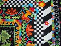 Simply Susan.  I like the mix of colors and designs.  Love the checkered border too!