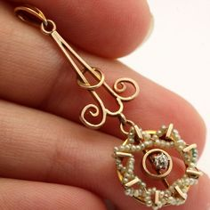 The gold work in this piece is beautifully carved out of 10k rose gold and features a stunning lavaliere style design!