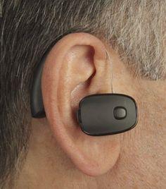 black amplifier shown behind the ear