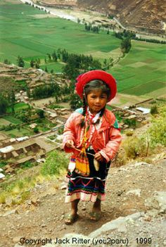 Little girl, with the Sacred Valley of Peru, behind. Image © Jack Ritter