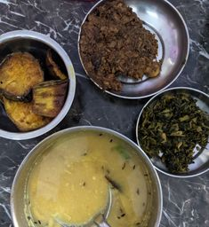 (clockwise from bottom) dal, brinjal fry, banana blossom side, spinach-potato