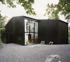 This wood panelled house and studio in Nacka, Sweden, is by Swedish studio In Praise of Shadows.