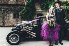 Jojo and Andy were married in August at Nettlestead Place, Kent. While the groom wasn't too bothered about having a big wedding, the bride wanted something special and so a steampunk theme it was! She wore a corset from Baba Studio with an AMAZING purple and turquoise skirt, made for her by Sisters of the Moon on Etsy. Her biker boots were from eBay.