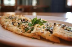 7-11-13 special is a Gorgonzola and fig flat bread appetizer with garlic oil, walnuts and Italian parsley for $6. Available until the kitchen closes!