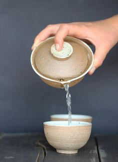 This teapot is called a shiboridashi in Japanese and gaiwan, or lidded bowl, in Chinese.  It is a palm-sized pot without a handle, for the brewing of fine green, white and oolong teas. This teapot is made from stoneware clay, by Talya Giladi, designed and created to illuminate the complex flavors of any tea brewed inside. It holds 100 ml / 3.4 oz , enough for one bowl of tea or two small cups.  This listing is for one shiboridashi teapot and a tea cup, another tea cup is optional. for more…