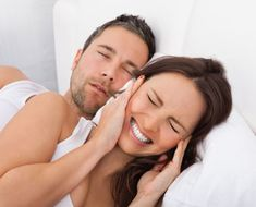Snoring is often a symptom of a more serious condition called obstructive sleep apnea. Snoring is caused by the relaxed tongue obstructing the passage of air into the lungs during sleep. Most of the time, the body gets just enough air so no real harm occurs. However, it can be a sign of sleep apnea, which can be very serious.