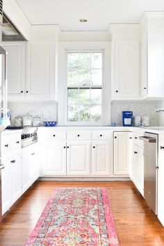 we transformed our kitchen without any major renovating... it was dark and dated before but now it's so bright and cheerful!
