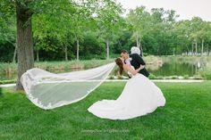 Wind blown veil wedding photo