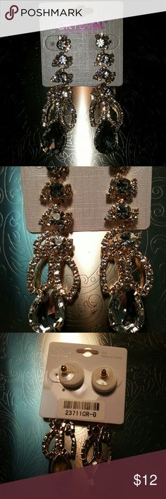 Bling, Bling Dangle Crystal Earings- Post Bling, Bling Dangle Crystal Earings- Post  3 inch length , 2 inch width. GREAT SPARKLE.  Awesome for New Years Eve outfit.  Light weight- plastic body. Post backing. Life by Design  Jewelry Earrings