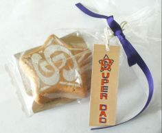 """Super hero """"Super Dad"""" star badge made from Vanilla clotted cream, all butter fudge. Clotted Cream, Super Dad, Fathers Day Gifts, Fudge, Paper Shopping Bag, Vanilla, Butter, Hero, Star"""