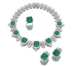 JEWELS FROM THE COLLECTION OF LILY MARINHO (LOTS 421-424) Impressive Emerald and diamond necklace and a pair of ear clips and a ring 325,000 — 525,000 CHF LOT SOLD. 1,202,500 CHF (Hammer Price with Buyer's Premium) DETAILS & CATALOGUING Impressive Emerald and diamond necklace and a pair of ear clips and a ring The necklace centrally set with seven step-cut emeralds framed with brilliant-cut, pear- and marquise-shaped diamonds, the cluster spacers set with similar stones, mounted in white…