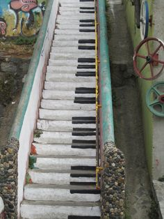Stairs painted to look like a piano.