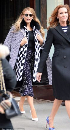 Sister, sister:Robyn, her 45-year-old sister of Teen Witch fame, wore navy and white stri...