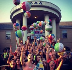 Cute beach balls with the names of new members written on them for bid day