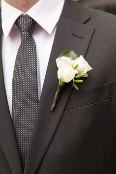 Classic attire for the groomsmen with a white rose and polka dot tie. photo: www.eyecontact.ca