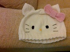 I have seen pics of different Hello Kitty hats online, but could never find a pattern so I just made it up as I went. I take no credit for the awesome concept/idea of the hat as I've seen HK hats based on the Kittyville pattern, one from Olsofia, etc. I wasn't planning on posting the pattern, but a couple people have asked me for it, so here it is…