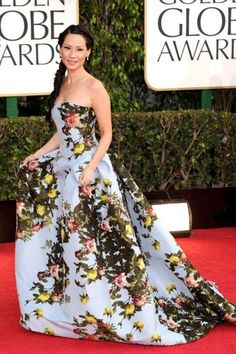Lucy Liu in a Carolina Herrera gown (drape and wallpaper-inspired).
