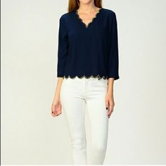 Moon Collection Lined Edge Shirt Moon Collection Lined Edge Shirt Has Arrived! Navy with adorable gold beaded detail on the neckline and hem. 100% Polyester. Hand wash. Photos courtesy of Moon Collection. Moon Collection Tops Blouses