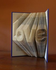 Unique Wedding Gift / Decoration - LOVE - Centerpiece - Paper - Altered Book - Book Lovers - Engagement Gift. $80.00, via Etsy.