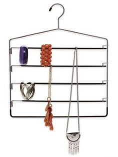 Look no farther than your closet for a jewelry organizer: a five-rung pants hanger makes a great holder for bracelets and necklaces.  I add shower curtain rings for slipping scarves thru!  Also, add snap on skirt clips to accomodate belts and gloves.  I also use this type of 5 tier pants hanger for storing folded tablecloths!