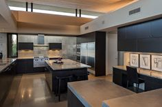 The stunning chef's #kitchen boasts a combination of sanded stainless steel, granite countertops and hand-cut #painted glass tiles. The kitchen is organized with sleek and ergonomincally functional #cabinets , allowing its top-of-the-line applicances to be concealed yet easily accessible.