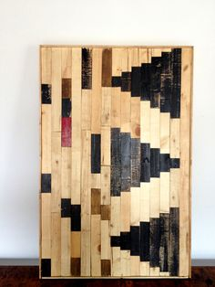 Wood mosaic wall art by Tracy T. Made of wood scraps and inspired by patterns and textures experienced while traveling through Africa.