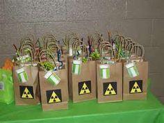 Science favor bags/ideas- Eyeball rubber ball Test tube with rock candy / chocolate rocks / rainbow stripe fruit leather Atom/molecule bouncy ball Glow sticks Pop rocks