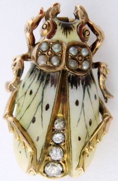 Antique Art Nouveau pearl, enamel, and diamond beetle pin, circa 1900. Via Diamonds in the Library.