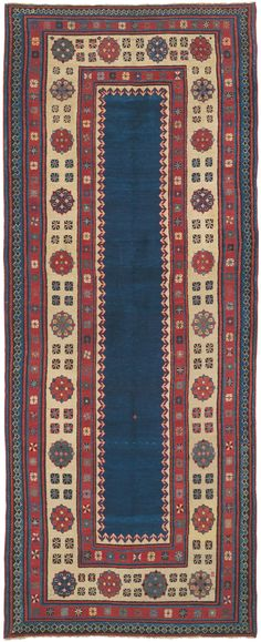 Caucasian Talish, 3ft 6in x 8ft 8in, Circa 1875. This superlatively crafted short runner features a deeply saturated, virtually unadorned field of Prussian blue. Framing it is a wonderfully spacious, chiseled rendition of the classical Talish repeating rosette border design. Combined with unusually lustrous wool, this produces the awe-inspiring, regal atmosphere of this rare piece from the Southern Caucasus.
