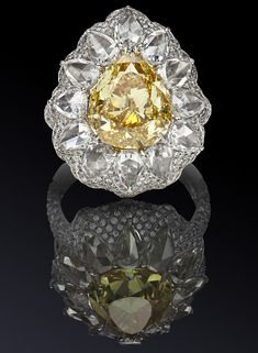 "Rosamaria G Frangini | High Yellow Jewellery | A Cocktail ring in white gold with pear-shaped yellow diamond weighing more than 5 carats, surrounded by diamond cut ""rose"", a total of 3.22 carat diamond and vualevoj inlay."
