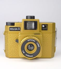 Holga 120CFN Camera Gold $95 NZD Camera Nikon, Film Camera, Holga, Razzle Dazzle, Vintage Cameras, Classic Films, Leica, Vintage Accessories, Binoculars
