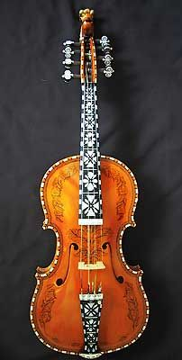 Hardanger fiddle made in 2000 by Lynn R Berg. The back, sides and neck are maple and the top of spruce. The decoration is mother of pearl and bone.