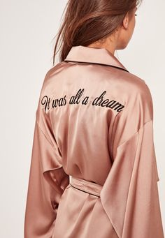 Get your best bedroom eyes on in this robe - featuring a rose gold hue, slogan on the back and contrast black piping for a luxe finish.