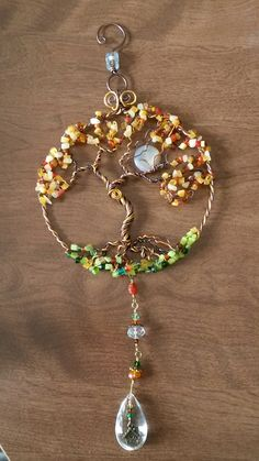 Wire wrapped beaded Tree of life sun catcher with moon and birdhouse pendant.