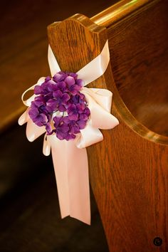 Purple flower arrangement for the church pews -Wedding at St. Anselms Church, San Anselmo {Photo by Bustle & Twine}
