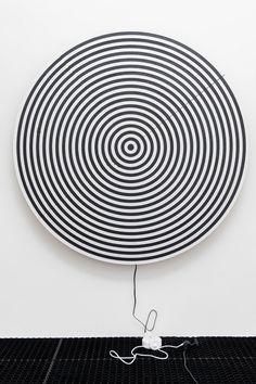"Ned Vena [USA] (b 1982) ~ ""Target Painting GGG (Plug)"", 2014. Polyurethane and rubber on linen, motor (163 x 3 cm). | b | #art #painting #sculpture #hardedge #minimalart #conceptualart #installation #kineticart"