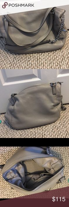 Michael Kors large grey Chandler bag/tote Used in great condition is a Michael Kors Large Chandler Tote in Pearl Grey. This bag is awesome! It was one of my favorites. But I'm looking to get something smaller. Bought for full price at Macy's during the winter. The only flaw with this bag is a very faded small pen mark on the bottom of bag. You really don't see it unless you look for it. See fourth Fast shipping. Michael Kors Bags Shoulder Bags