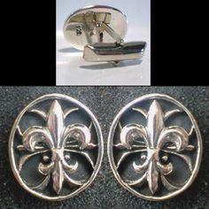 solid sterling silver fleur-de-lis oval cufflinks.
