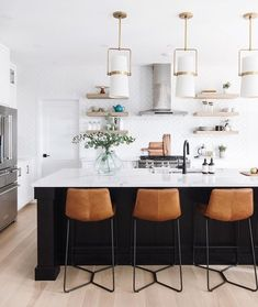 Home Interior Layout Brown Leather Counter Chairs for a black kitchen island with white marble countertops via Leclair Decor Black Kitchen Island, Stools For Kitchen Island, Counter Stools, Küchen Design, Home Design, Design Trends, Interior Design, Home Decor Kitchen, New Kitchen