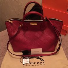 """100% Authentic Burberry Medium Pebbled Leather 100% Authentic Use like brand-new only worn 3 times: Burberry Pebbled Leather Tote Bag: COLOR MILITARY RED: Top zip closure. Detachable, adjustable shoulder strap.Logo-jacquard lining. Exterior slip pocket with magnetic closure. Interior zip wall and cell-phone pockets. Leather. Fully Lined By Burberry; imported 16""""W X 11""""H X 4½""""D: No scratches no scuffs no stains on the inside the bag is practically flawless: Bought online at Bloomingdale's…"""