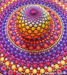 Elspeth McLean mandala in purple, orange and blue colors