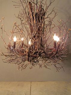 Twig chandelier... So pretty. I want in a bedroom spray painted white.