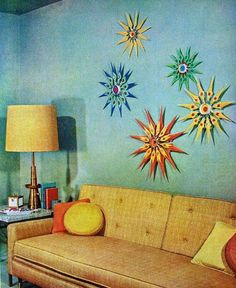 Living room design 1957 those colorful starbursts, the blue wall.  i grew up with that sofa and let it go in the late 80's.  big mistake.