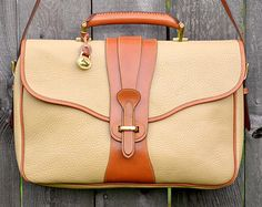Strolling in the park with this vintage Dooney & Bourke briefcase