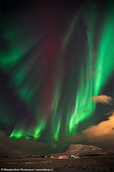 """Aurora Borealis dance in Iceland. I saw the """"northern lights"""" when I was on a C-130 flying through Alaska; they're amazing from the air!!"""