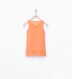 Organic cotton tank top with embroidered hem