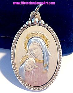 $95 Large Pendant from Italy. Blessed Mother, Virgin mary, with baby Jesus STUNNING HEIRLOOM EMBOSSED STERLING SILVER PENDANT in a *SILVER PLATED casing! VERY DETAILED! Pastel colors of blue, gold, pink on sterling silver medal that is enclosed in a silver plated copper casing. Almost 2 inches tall , Artisan handcrafted in Italy