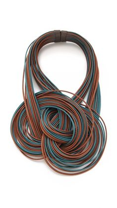 Lanno Antonela Necklace: two-tone cords and metallic leather accents on the magnetic clasp.